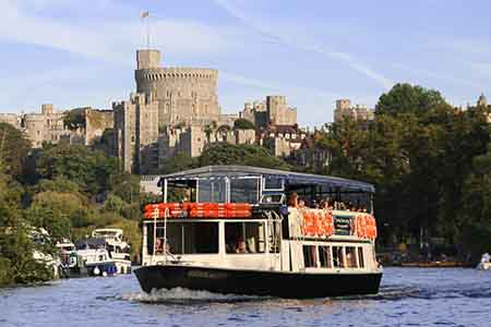 A river boat in front of Windsor Castle.